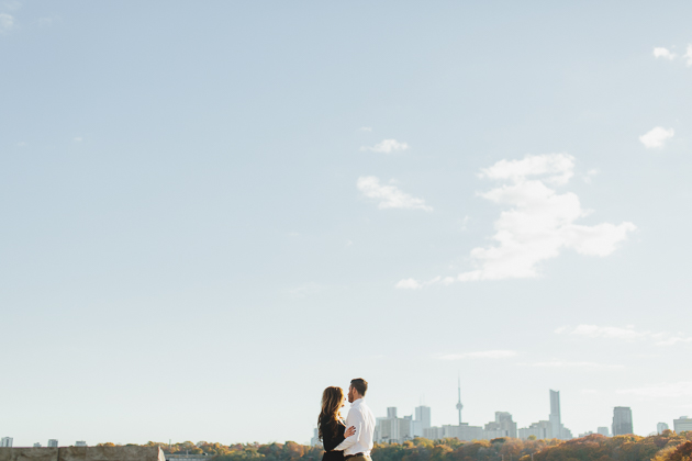 Sunset engagement pictures overlooking the CN Tower at Evergreen Brick Works