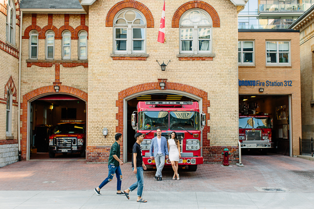 This couples used a fire truck as their prop for their engagement pictures