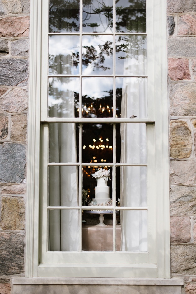 A look at the wedding cake through a window at Graydon Hall Manor