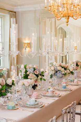 Towering candle holders at this elegant Graydon Hall Manor wedding reception