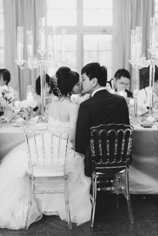 Seal the kiss! A Bride and groom share a tender moment during their wedding reception at Graydon hall Manor