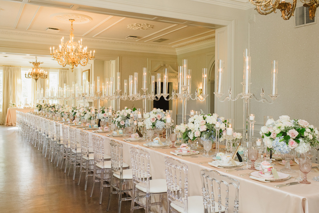 Rows of tall candle holders at the lush Graydon Hall Manor wedding