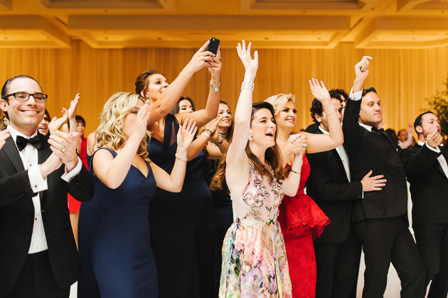 Wedding guests cheering for the bride and groom