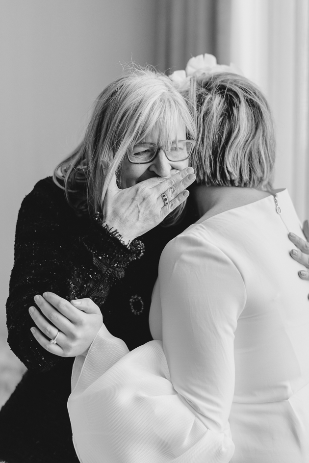 A happy mother can't hold her tears back as she sees her daughter as a bride for the very first time