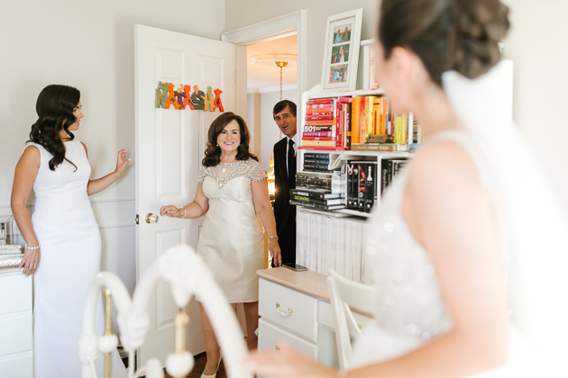 A mother enters a room to see her daughter as a bride for the very first time