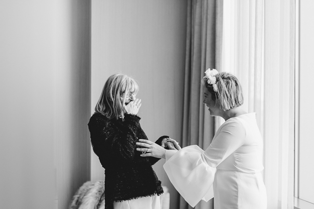 A mother cries when she sees her daughter as a bride on the morning of the wedding