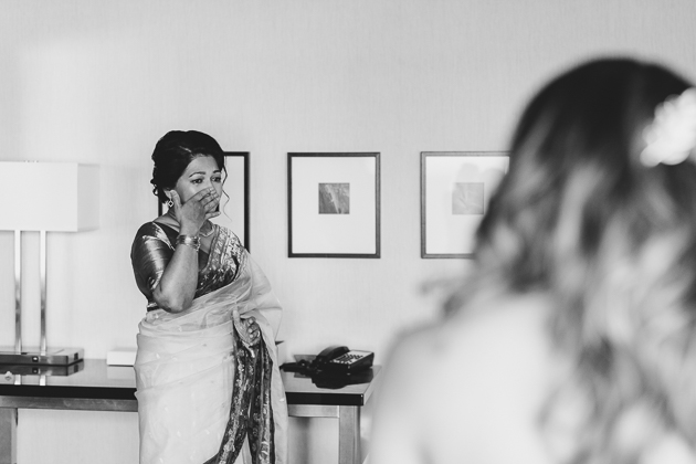 A mother tears up when she sees her daughter as a bride for the first time