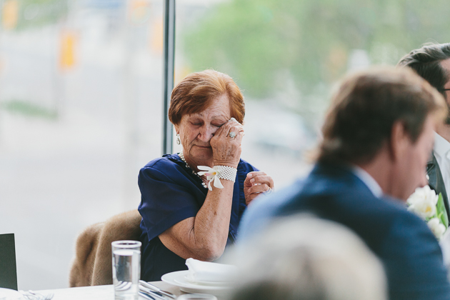 A mother tears up during the wedding reception