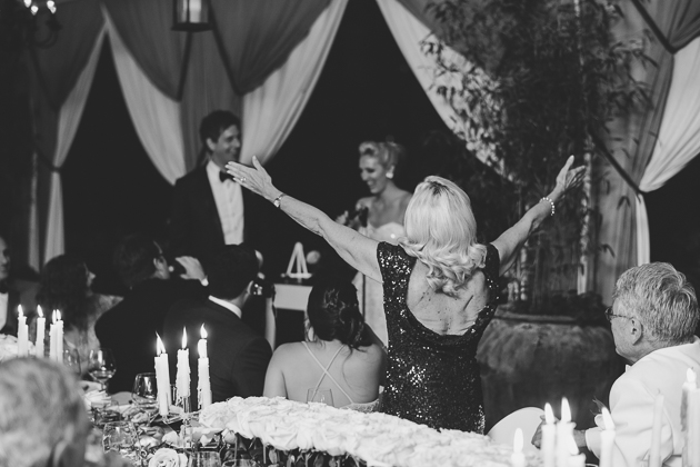 A happy mother cheers for her children during the wedding reception
