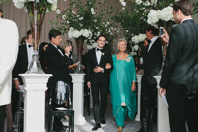 A happy mother walking down the aisle with her son