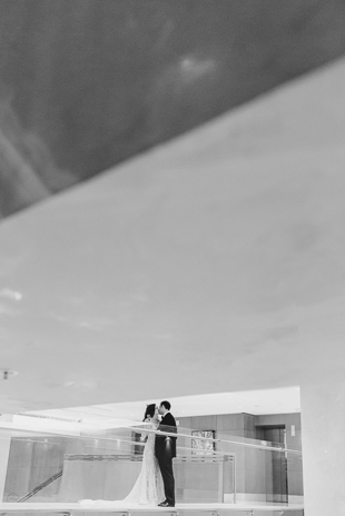 Dramatic lines make our photography hearts flutter! Our beautiful couple on the stairs of Ritz Calrlton