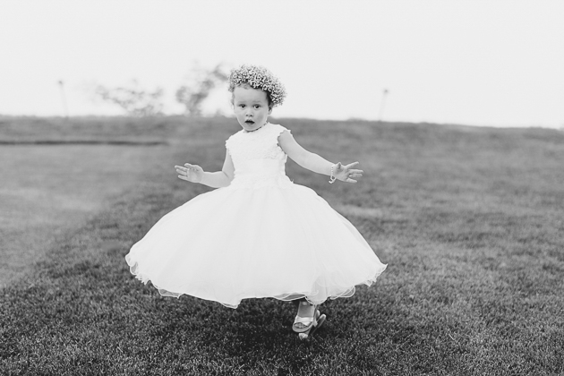 A flower girl dancing on the green field