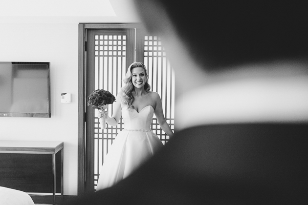 A bride is happy to see her fiancé during the first look