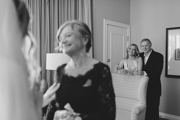 Parents looking at the bride and can't contain their joy