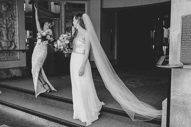 A bride and her bridesmaid exiting the wedding ceremony happily