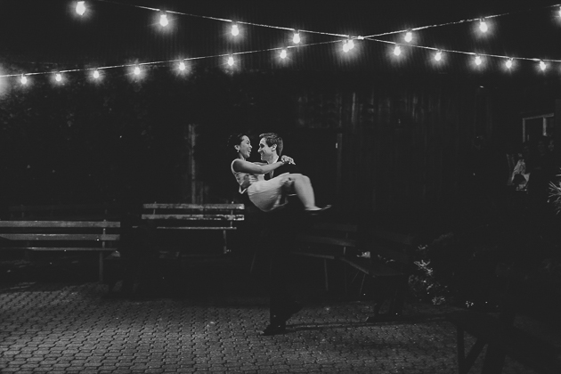 A bride and the groom dancing alone after the wedding reception