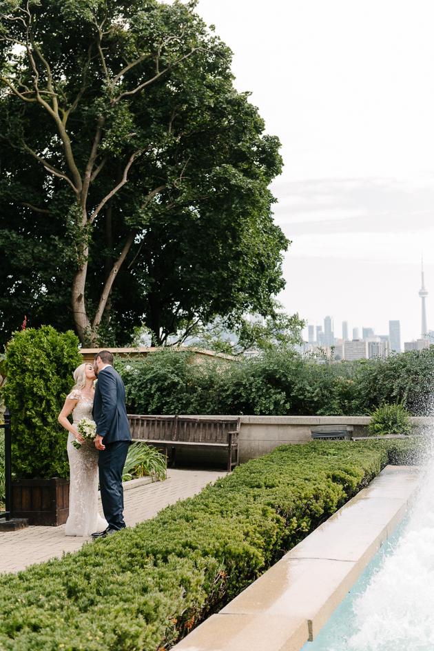 A tender kiss at Casa Loma wedding
