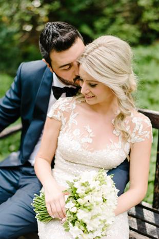 A bride and groom having a quiet morning at Casa Loma garden