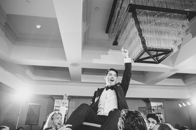 A groom having the time of his life during the horah