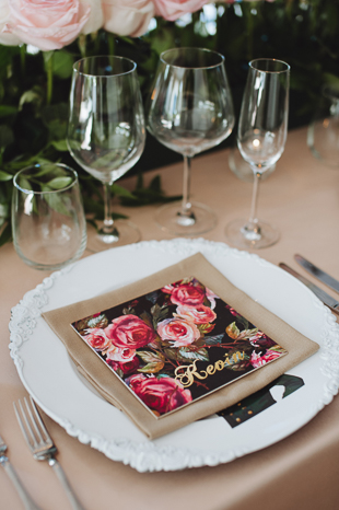 Custom rose napkin at this wedding reception are so cute!