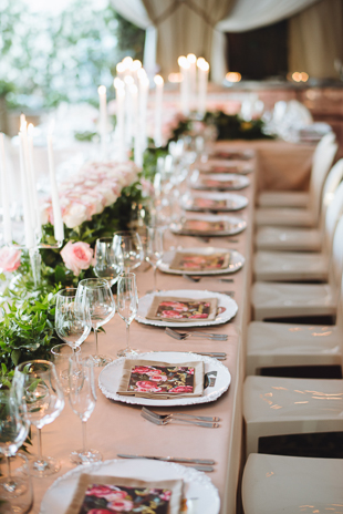 Pink roses and custom made artwork at this pretty wedding reception
