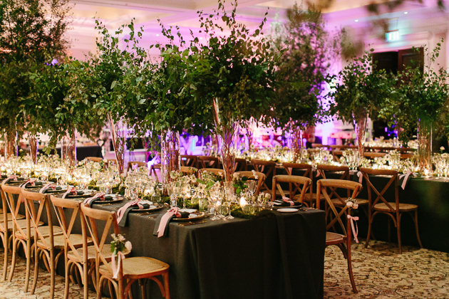 Life size trees at this forest inspired wedding at Four Seasons