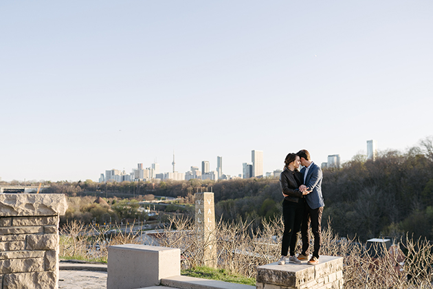 Sunset engagement photo at Evergreen Brickworks with Toronto skyline