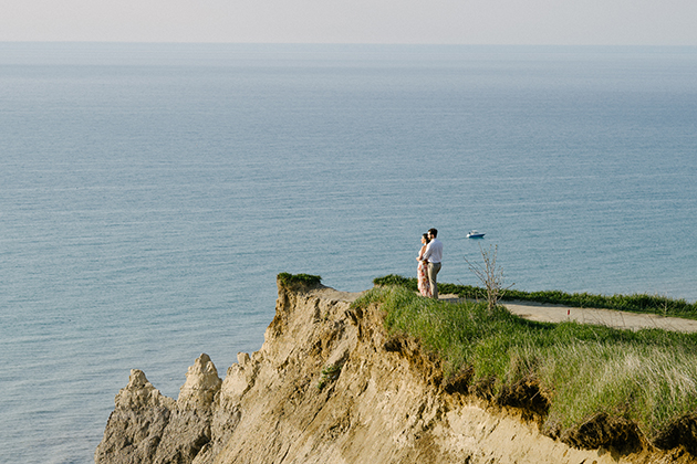Couple at the top of the Scarborough Bluffs for engagement photos