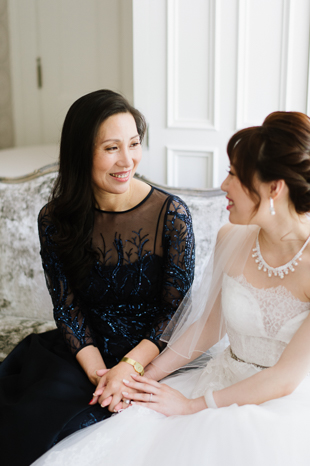 Bride and her Mother exchanging smiles before the ceremony