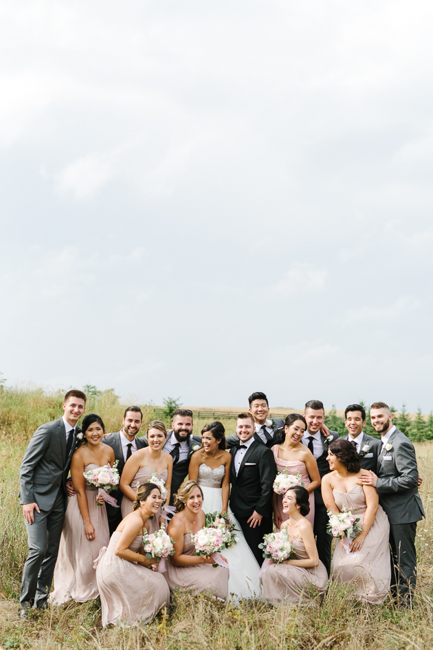A bridal party portrait on a sunny day