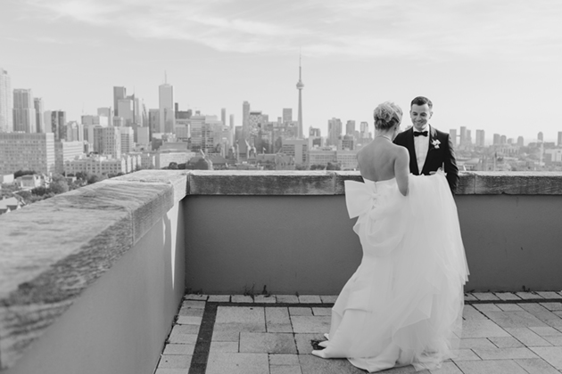 A bride and groom moments after their First Look at Park Hyatt Toronto