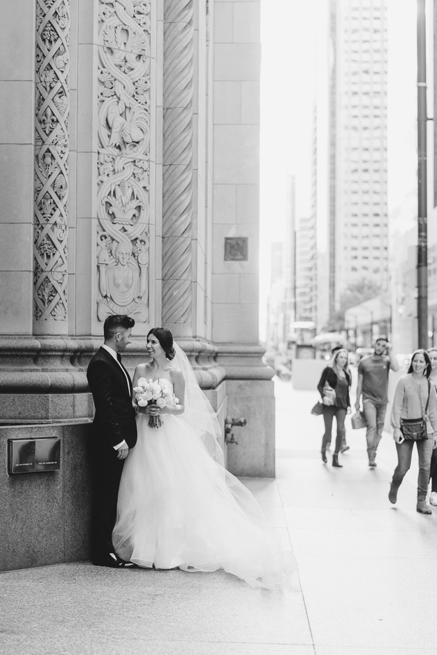 A bride and groom enjoying a quiet moment in the heart of Toronto during their wedding portraits