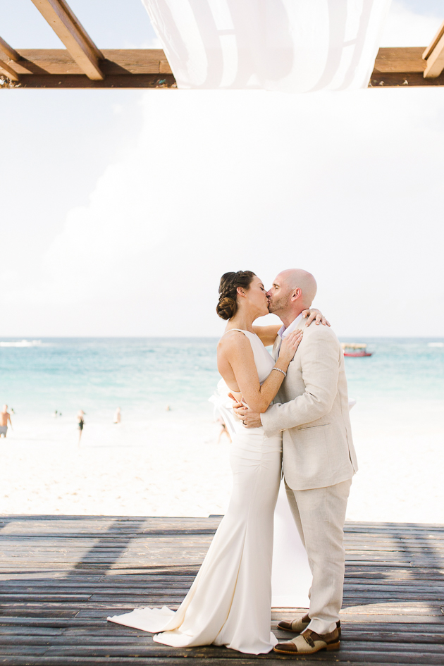 First kiss as husband and wife at the beach wedding