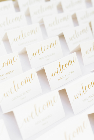 Pretty hand-written seat cards at a beach wedding inspiration