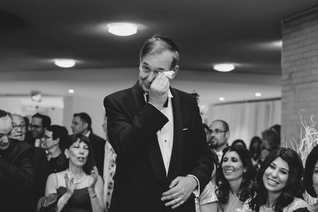 A father tearing up during the wedding ceremony