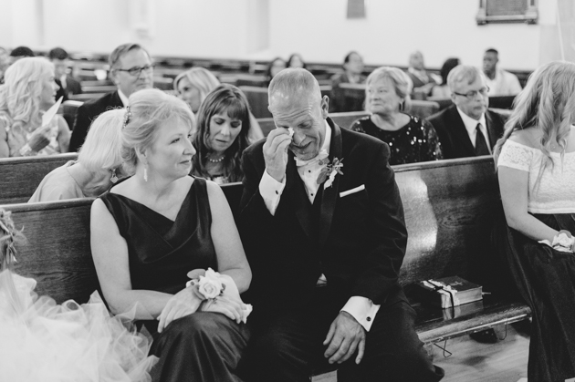 A father of the groom can't help but tear up during wedding ceremony