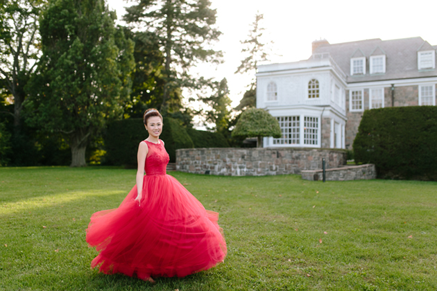 This bride rocked a red wedding dress for her wedding reception at the Estates of Sunnybrook