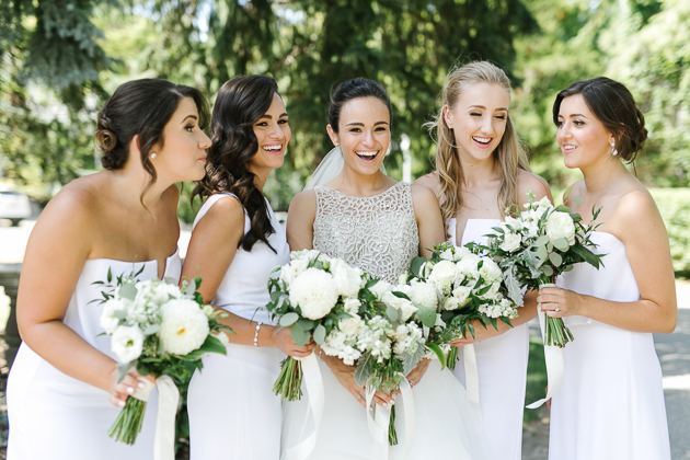 A bride and her bridesmaids sharing a few laughs before her Eagles Nest Wedding