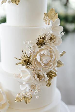 White and gold wedding cake at the Eagles Nest wedding reception