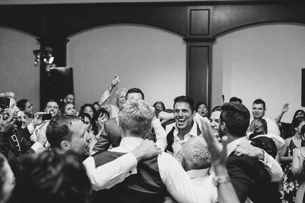 Groomsmen having fun at the Eagles Nest wedding reception in Toronto