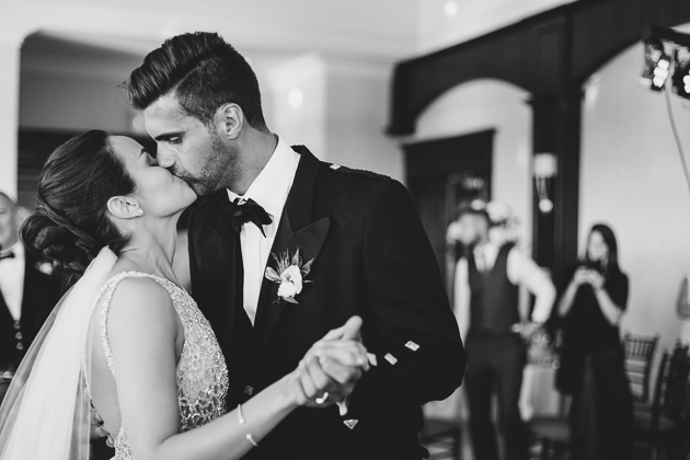 The bride and groom kiss during their first dance at the Eagles Nest wedding reception