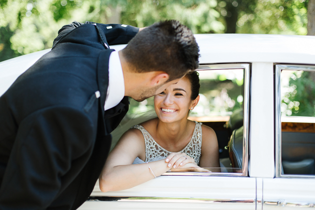 A groom is picking up his bride at the Glendon College for wedding photos