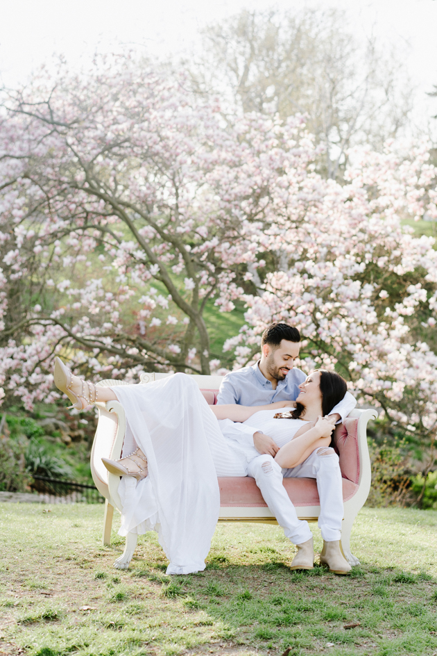 Spring engagement photos are extra special if you catch a blooming magnolia tree!