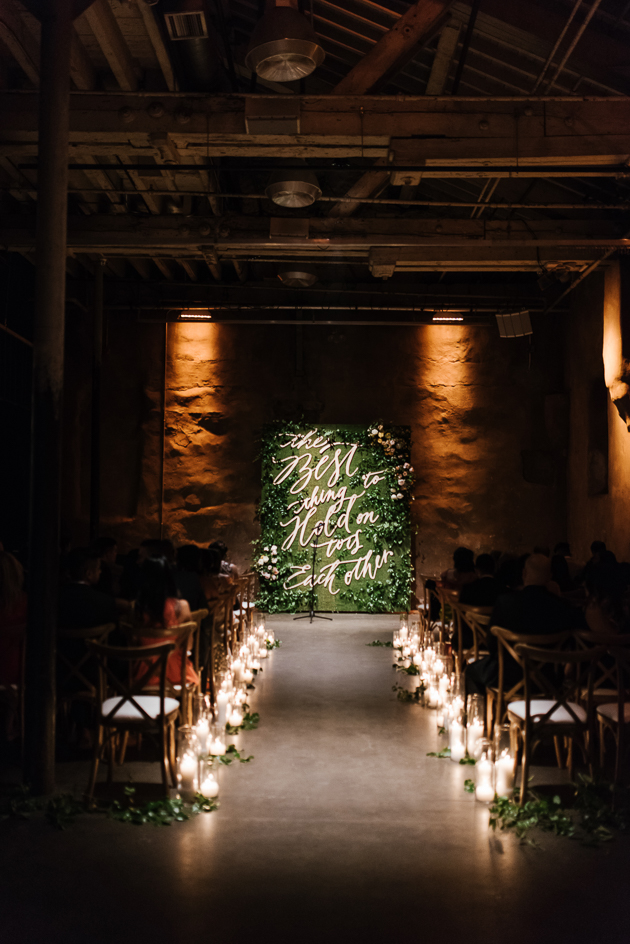 Unique greenery ceremony backdrop at the romantic  Fermenting Cellar wedding in Distillery District