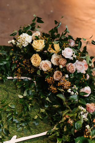 Lush yellow and blush flowers at the romantic  Fermenting Cellar wedding in Distillery District
