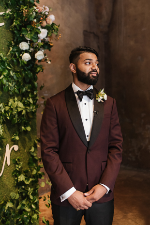 A groom waiting for his bride at the Fermenting Cellar wedding in Distillery District