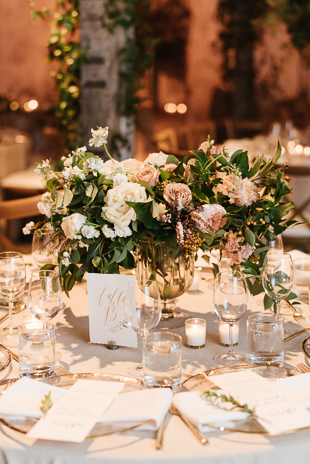 Lush greenery and blush floral arrangements at the romantic Fermenting Cellar wedding in Distillery District