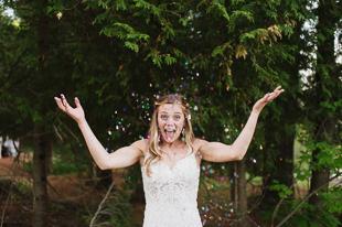 A bride throwing confetti during her Muskoka wedding