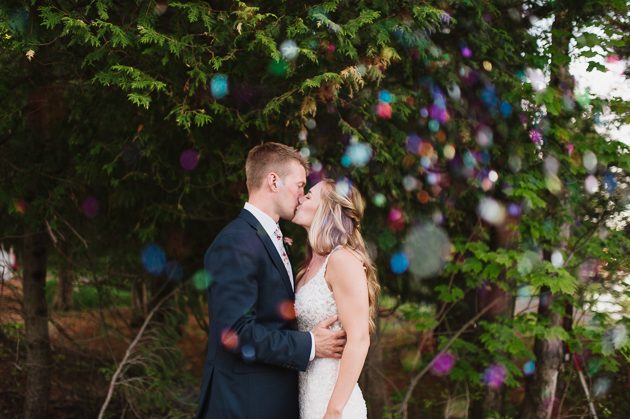 A bride and groom portrait with confetti