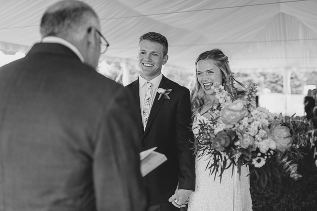 A bride and groom's happy smiles during their Muskoka wedding ceremony